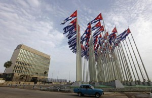 A car drives past the building of the the U.S. diplomatic mission in Cuba, The U.S. Interests Section, (USINT), in Havana,  September 12, 2013.  REUTERS/Desmond Boylan