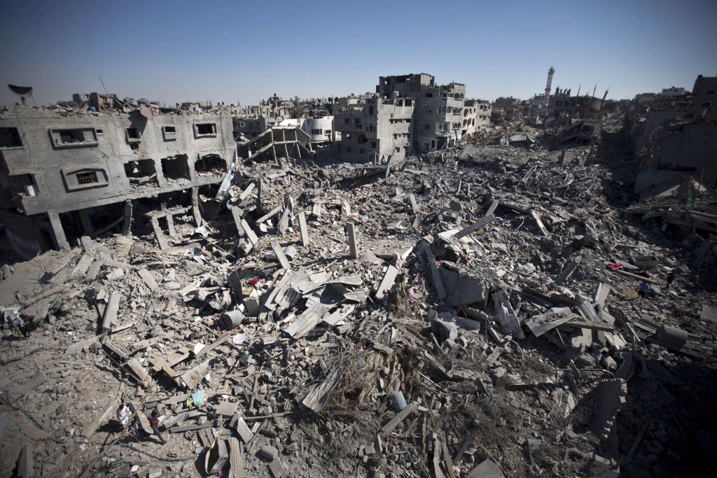 TOPSHOTS A picture taken on July 26, 2014 shows the rubble of destroyed buildings and homes in the Shejaiya residential district of Gaza City, as families returned to find their homes ground into rubble by relentless Israeli tank fire and air strikes. The death toll in Gaza soared to more than 1,000 as bodies were pulled from the rubble during a 12-hour truce top diplomats urged Israel and Hamas to extend. AFP PHOTO/MAHMUD HAMSMAHMUD HAMS/AFP/Getty Images